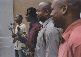 Bachelor Men Hold Roses